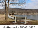 The Empty Wood Bench On The...