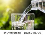 drinking water pouring from... | Shutterstock . vector #1036240708