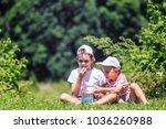children eat raspberries on a... | Shutterstock . vector #1036260988