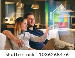 a couple sitting on the sofa...   Shutterstock . vector #1036268476