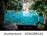green lake middle of the valley | Shutterstock . vector #1036288162