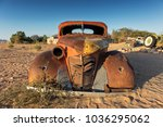 old and abandoned car in the... | Shutterstock . vector #1036295062