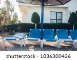 sun loungers and beach... | Shutterstock . vector #1036300426