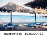 sun loungers and beach... | Shutterstock . vector #1036300432