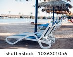 sun loungers and beach... | Shutterstock . vector #1036301056