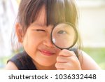 asian little girl looking... | Shutterstock . vector #1036332448