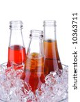Three Open Soda Bottles in Glass Ice Bucket isolated over white - stock photo