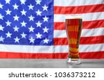 glass of beer on table against... | Shutterstock . vector #1036373212