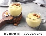 glass jars with vanilla pudding ... | Shutterstock . vector #1036373248