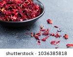 hibiscus tea in black bowl.... | Shutterstock . vector #1036385818