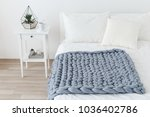 bed with white linen and grey... | Shutterstock . vector #1036402786