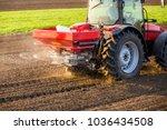 farmer fertilizing arable land... | Shutterstock . vector #1036434508