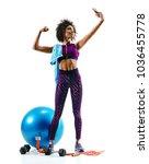sporty girl taking selfie... | Shutterstock . vector #1036455778