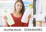 woman shopping at the... | Shutterstock . vector #1036464382