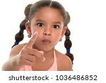 small multiracial girl pointing ... | Shutterstock . vector #1036486852