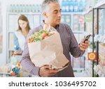 man shopping at the supermarket ... | Shutterstock . vector #1036495702