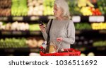 mature white lady in produce... | Shutterstock . vector #1036511692