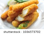 cheese stick on table | Shutterstock . vector #1036573702