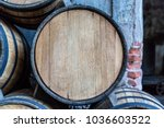 wine barrels stacked in the old ... | Shutterstock . vector #1036603522
