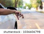man's hand throwing plastic...   Shutterstock . vector #1036606798