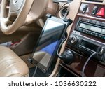 tablet computer in the car | Shutterstock . vector #1036630222