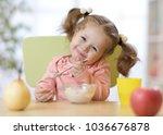 funny child toddler eating...   Shutterstock . vector #1036676878