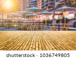 wooden floor front of bokeh... | Shutterstock . vector #1036749805