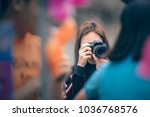 unidentifiled female... | Shutterstock . vector #1036768576