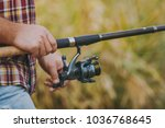 close up a man holds and... | Shutterstock . vector #1036768645