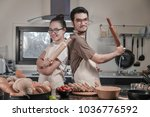 happy young couple cooking in... | Shutterstock . vector #1036776592
