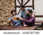 three guys watch the match...   Shutterstock . vector #1036787785