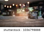 empty dark wooden table in... | Shutterstock . vector #1036798888