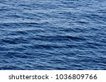 the calm waves of the sea. | Shutterstock . vector #1036809766