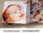 close up looking at baby s album | Shutterstock . vector #1036860445