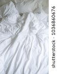 unmade bed with plain white bed ... | Shutterstock . vector #1036860676