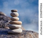 balanced stone on a peddle... | Shutterstock . vector #1036894066