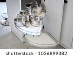 Stock photo solution for a kitchen corner storage in a cupboard a corner unit with pullout shelves for cookware 1036899382
