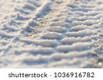 tire tracks in the frozen snow  ... | Shutterstock . vector #1036916782