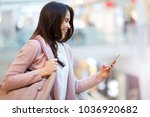 woman using mobile phone in... | Shutterstock . vector #1036920682