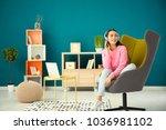 beautiful young woman listening ... | Shutterstock . vector #1036981102