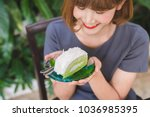 a piece of coconut cake on dish.   Shutterstock . vector #1036985395