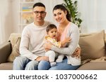 family  parenthood and people...   Shutterstock . vector #1037000662