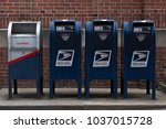 Small photo of Clarion, PA / United States - February 25 2018: USPS boxes in a row outside the post office