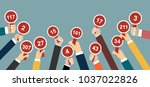 hands holding auction paddle.   Shutterstock .eps vector #1037022826