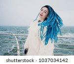 stylish hipster girl in white... | Shutterstock . vector #1037034142