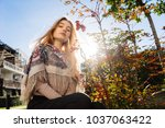 young cute blonde girl walks... | Shutterstock . vector #1037063422