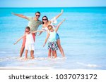 young family on vacation have a ... | Shutterstock . vector #1037073172