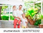 father and kids enjoying beach... | Shutterstock . vector #1037073232