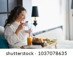 breakfast in bed  cozy hotel... | Shutterstock . vector #1037078635