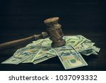 Small photo of Judges or Auctioneers Gavel Or Hammer And USD Money Cash On Wooden Courtroom Bench Or Auctioneer Table. Grunge Wood Background. Law, Monetary, Auction Bidding, Bankruptcy, Bail, Or Tax Concept